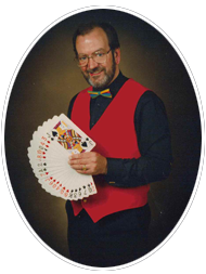 Russell King, magician, with playing cards